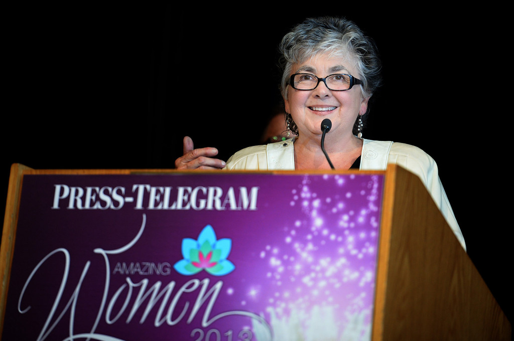 . Linda Silas receives the award for Health & Wellness at the Press Telegram Amazing Women 2013 Gala in Lakewood, CA. on Wednesday, November 13, 2013. (Photo by Sean Hiller/Press Telegram).