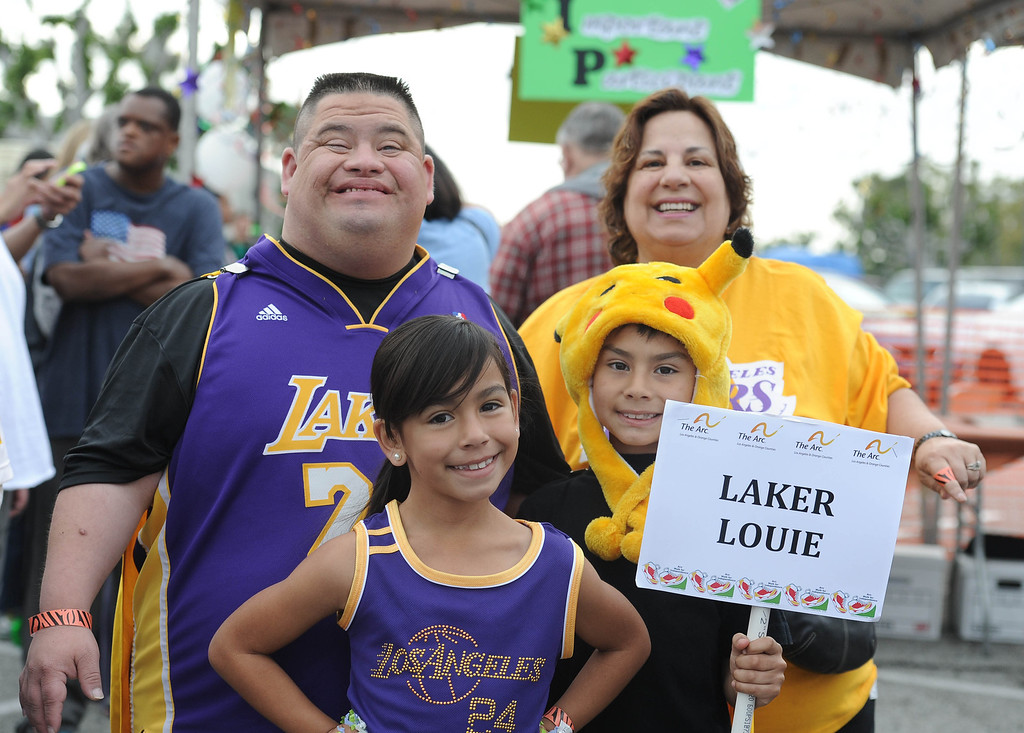 . Louie Gutierrez, left, leads Team Laker Louie with niece Samantha Cosio, left, and nephew Jacob Cosio at the Arc Walk for Independence at the Stonewood Center in Downey, CA. on Saturday March 22, 2014. (Photo by Sean Hiller/ Daily Breeze).