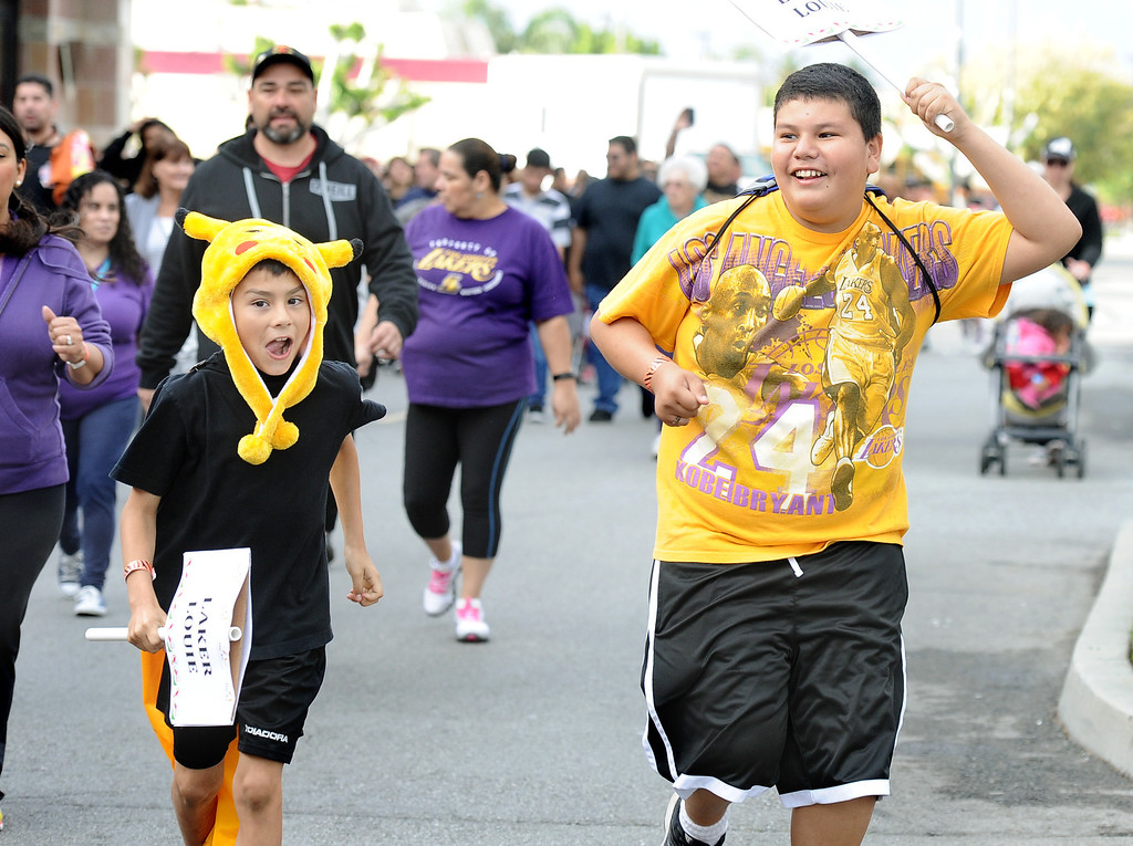 . Jacob Cosio, 9, left, and Jose Serrano,12, keeps the pace up for Team Laker Louie in support of Louie Gutierrez at the Arc Walk for Independence at the Stonewood Center in Downey, CA. on Saturday March 22, 2014. (Photo by Sean Hiller/ Daily Breeze).