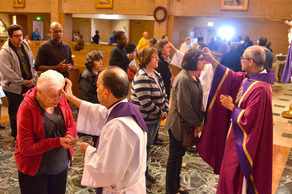 . Father Manny Bravo, far right. Ash Wednesday Mass at Mary Star of the Sea Catholic Church in San Pedro.   (March 5, 2014. Photo by Brad Graverson/The Daily Breeze)