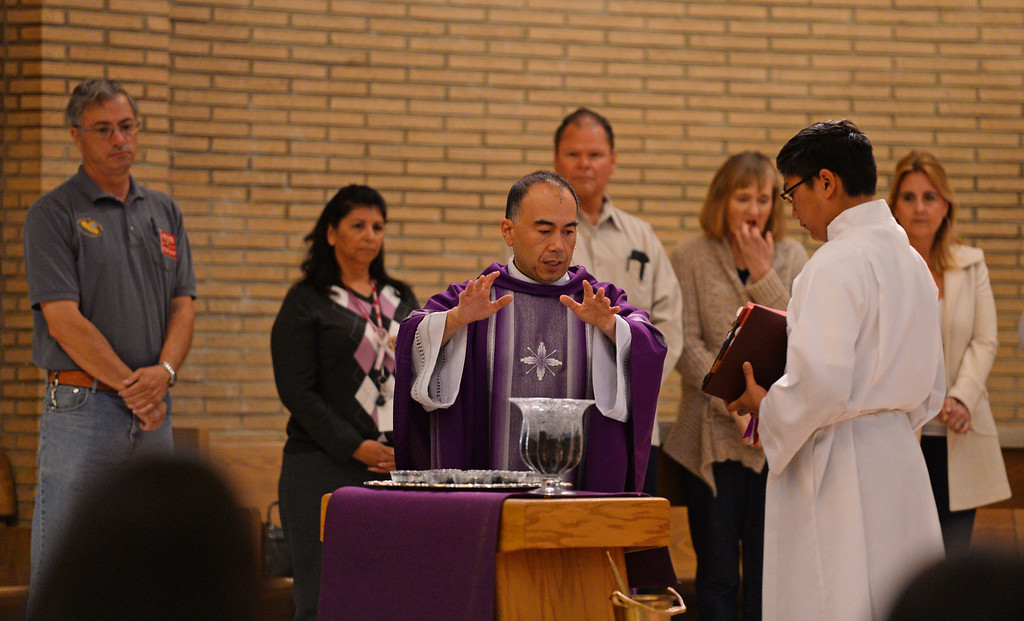 . Father Brian Nunez blesses the ashes during Ash Wednesday Mass at Mary Star of the Sea Catholic Church in San Pedro.   (March 5, 2014. Photo by Brad Graverson/The Daily Breeze)