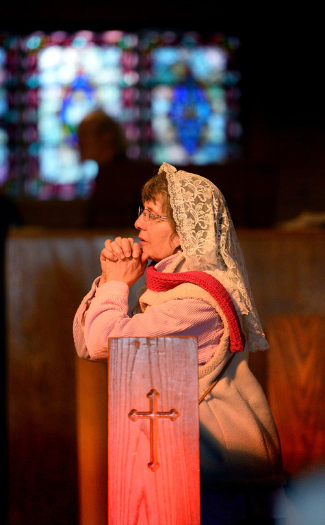 . Holly Oldenburg prays during Ash Wednesday Mass at Mary Star of the Sea Catholic Church in San Pedro.   (March 5, 2014. Photo by Brad Graverson/The Daily Breeze)