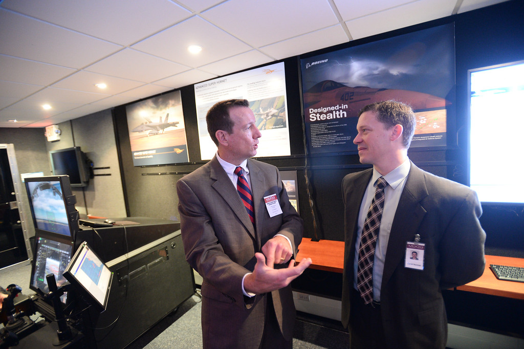 . Mike Gibbons, Boeing F/A-18 and EA-18G Programs Vice President and Dave Norman, Moog Military Aircraft Managing Director chat at rally held at Moog Aircraft Group in Torrance to support local jobs and more advanced fighter jets. Photo by Brad Graverson 3-21-14