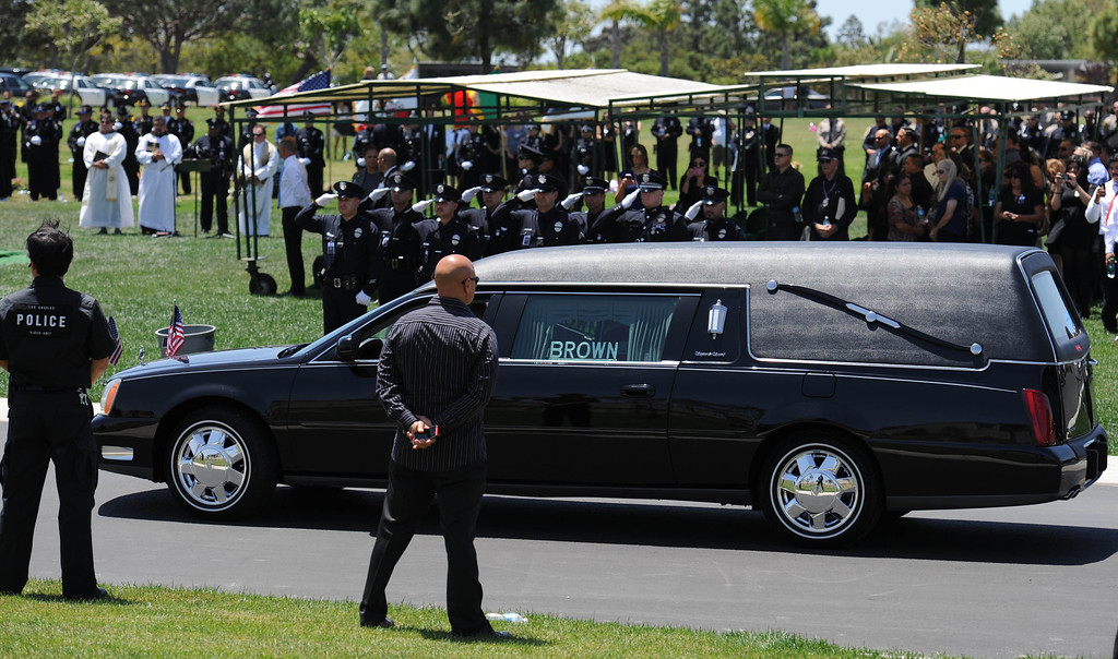 . Burial services for LAPD Officer Roberto Sanchez, at The Good Shepherd Cemetery in Huntington Beach. Officer Sanchez was killed May 3 in a car crash in Harbor City. The Good Shepherd Cemetery in Huntington Beach.   Huntington Beach Calif., Wednesday, May 14,  2014.     (Photo by Stephen Carr / Daily Breeze)