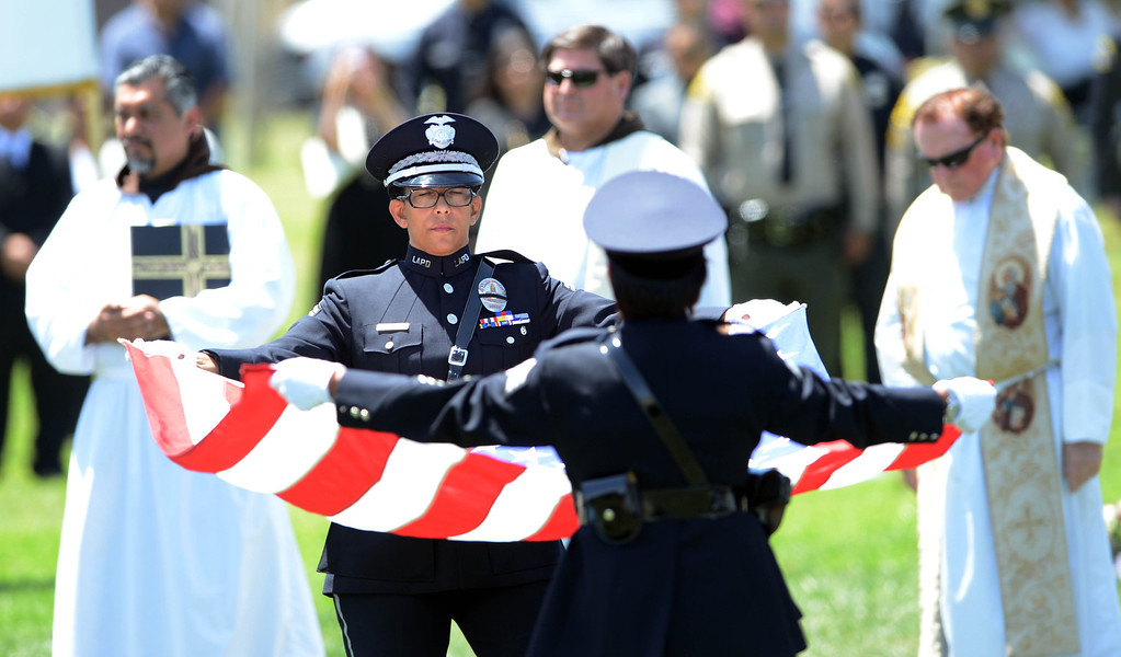 . A blessing during burial services for LAPD Officer Roberto Sanchez, at The Good Shepherd Cemetery in Huntington Beach. Officer Sanchez was killed May 3 in a car crash in Harbor City. The Good Shepherd Cemetery in Huntington Beach.   Huntington Beach Calif., Wednesday, May 14,  2014.     (Photo by Stephen Carr / Daily Breeze)