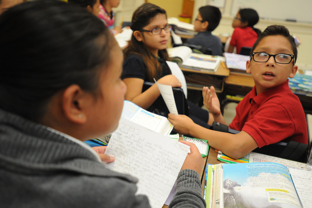 . Fifth grader Gerardo Cordova, right, joins classmates in a discussion at Lafayette Elementary, which is using the new Common Core standards being put into place at local schools that give schools nationwide common standards in math and English on Thursday, November 14, 2013. (Photo by Sean Hiller/Press Telegram)