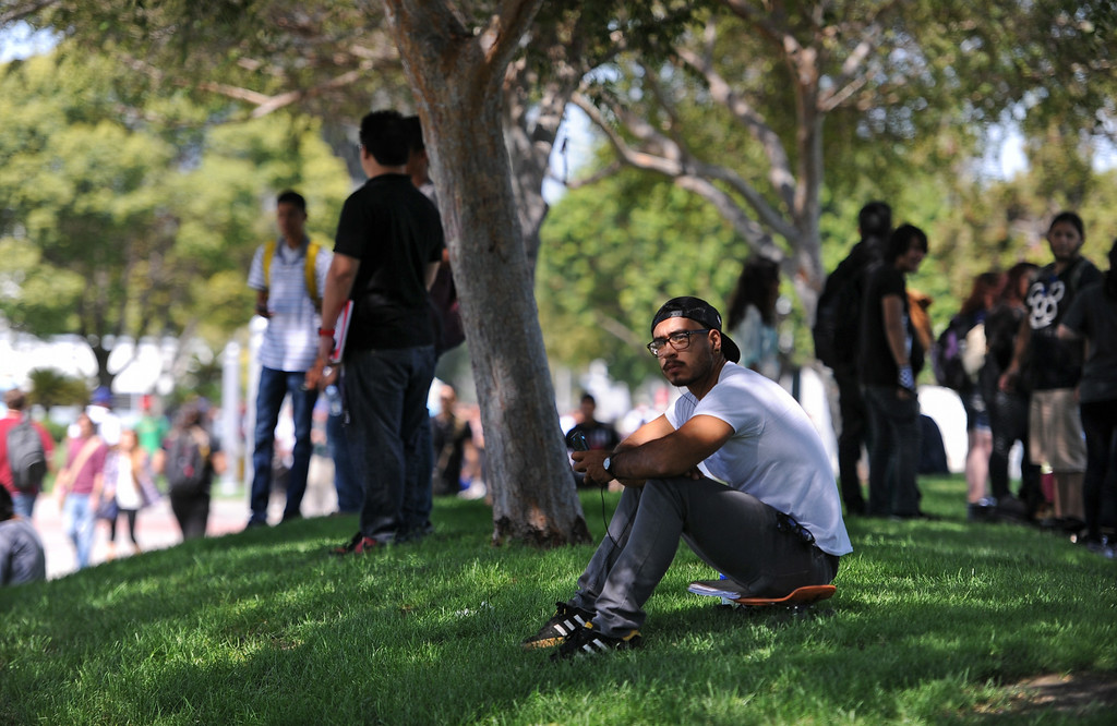 . Ulysses Betancourt, 23, is studying graphic design at Cerritos College. First day of classes at Cerritos College for the fall semester. Students will see new buildings, programs and food services. Enrollment is up 5.8%. (Aug. 18 2014 Photo by Brad Graverson/The Press Telegram)