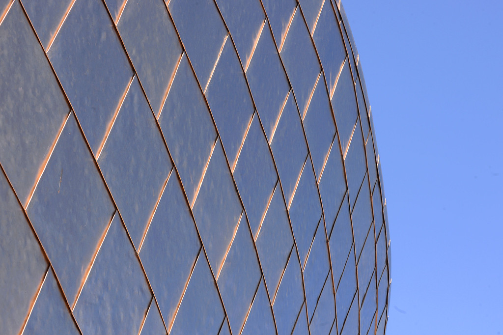 . Exterior is clad in titanium panels. The Cerritos Library is is more like a public information center and gathering place. Lots of books, but also art, music and computers.   (Fri Nov. 8, 2013 Photo by Brad Graverson/The Daily Breeze)
