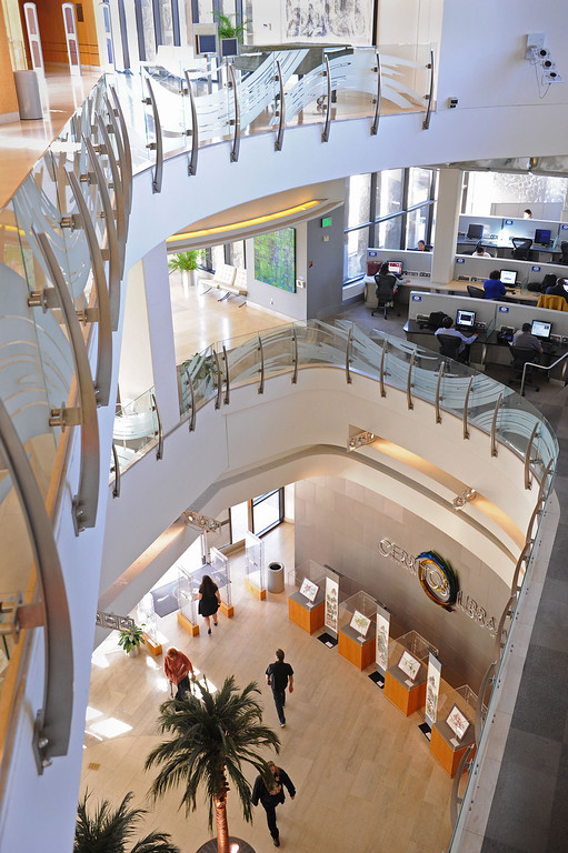 . Entrance and multi-level layout. The Cerritos Library is is more like a public information center and gathering place. Lots of books, but also art, music and computers.   (Fri Nov. 8, 2013 Photo by Brad Graverson/The Daily Breeze)