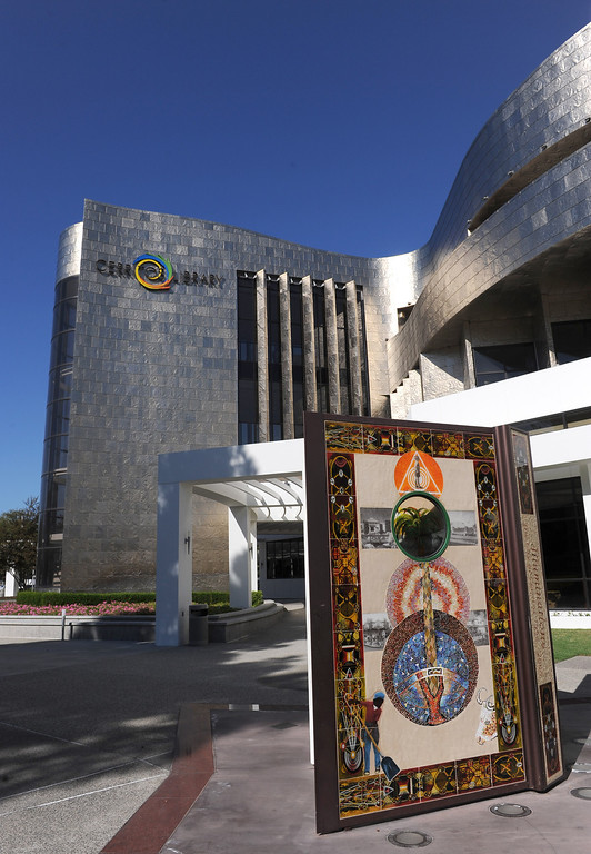 . The Cerritos Library is is more like a public information center and gathering place. Lots of books, but also art, music and computers.  Exterior with large book sculpture out front.  (Fri Nov. 8, 2013 Photo by Brad Graverson/The Daily Breeze)