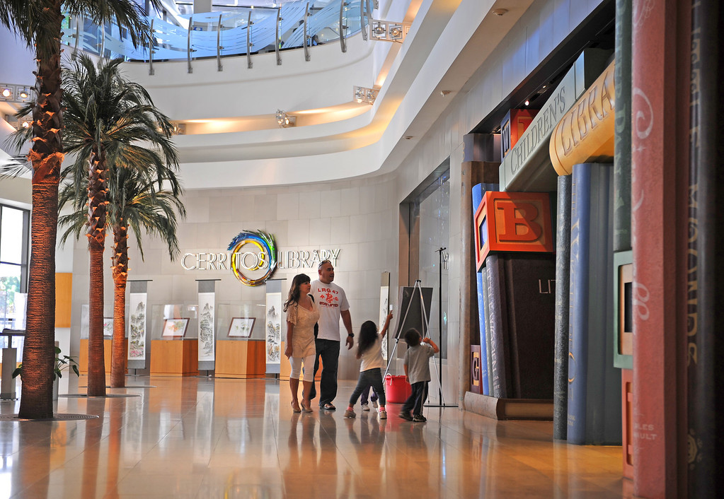 . Grand entrance leads past a salt water aquarium and Children\'s Library. The Cerritos Library is is more like a public information center and gathering place. Lots of books, but also art, music and computers.   (Fri Nov. 8, 2013 Photo by Brad Graverson/The Daily Breeze)