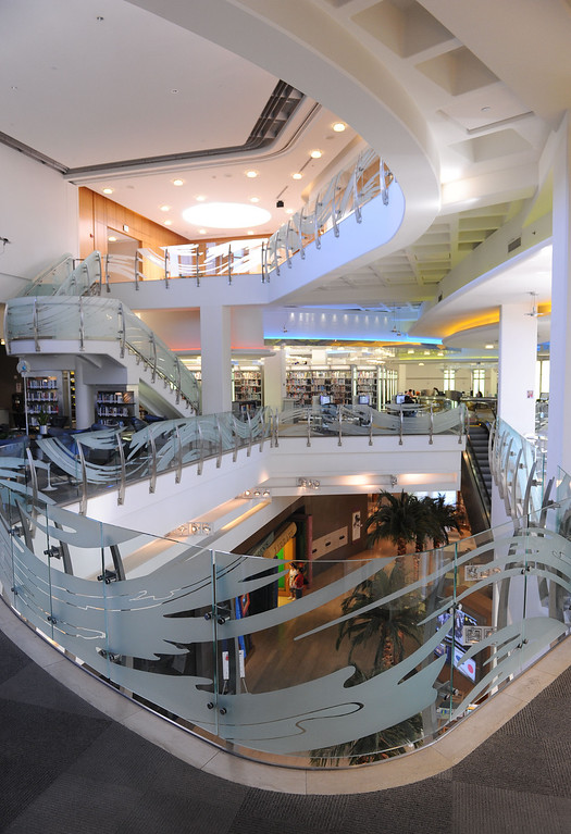 . Multi-level complex is a feast for the eyes. The Cerritos Library is is more like a public information center and gathering place. Lots of books, but also art, music and computers.   (Fri Nov. 8, 2013 Photo by Brad Graverson/The Daily Breeze)