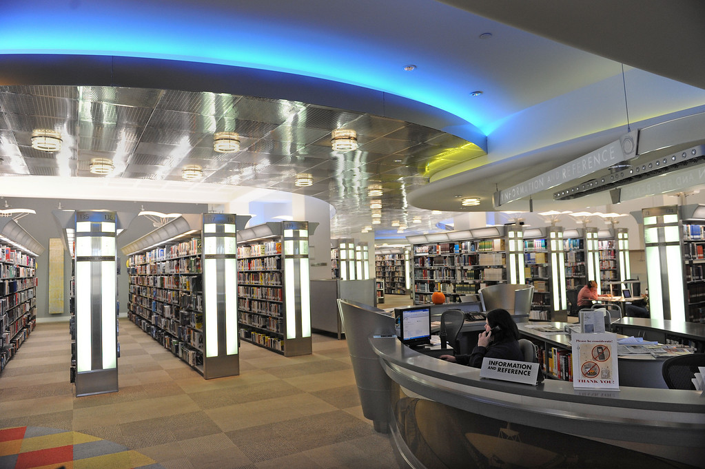 . Reference Desk in the 21st Century area. The Cerritos Library is is more like a public information center and gathering place. Lots of books, but also art, music and computers.   (Fri Nov. 8, 2013 Photo by Brad Graverson/The Daily Breeze)