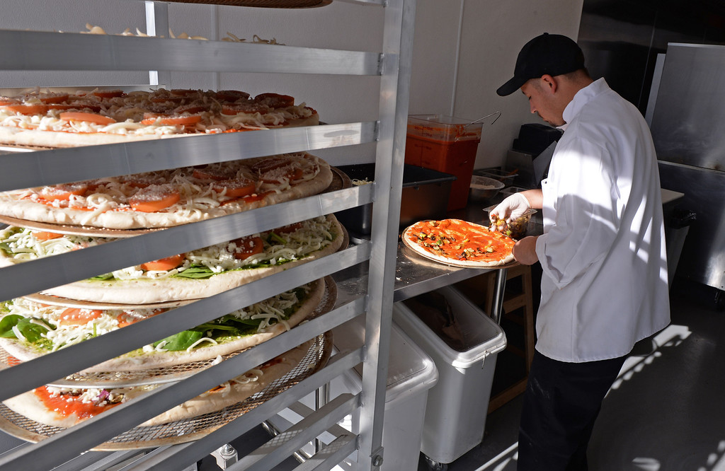 . Head cook Benjamin Perez makes pizzas. Chayo Eatery in Torrance is a kosher restaurant filling a niche in the local Jewish community. They make fresh pizzas, salads, soups and sandwiches. Photo by Brad Graverson/The Daily Breeze 01/03/14