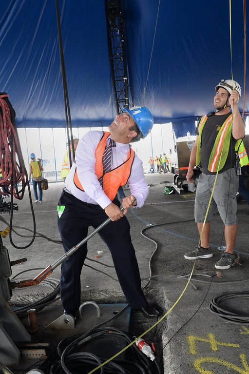""". LA Councilman Joe Buscaino operates a winch to tighen up the main Cirque du Soleil bigtop tent where the circus is setting up for its performance of \""""Totem\"""" starting Oct. 11. Set up is near the Lane Victory at berth 45. (Oct 2, 2013. Photo by Brad Graverson/The Daily Breeze)"""