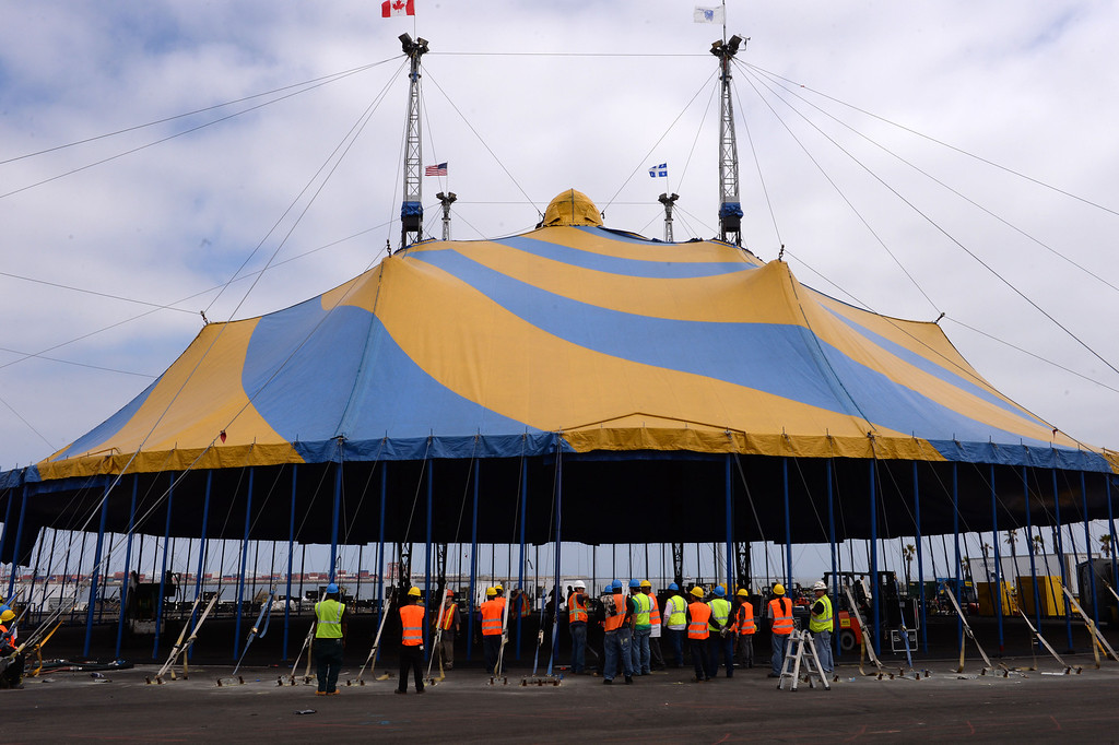 """. Workers push up the last poles of the main Cirque du Soleil bigtop tent where the circus is setting up for its performance of \""""Totem\"""" starting Oct. 11. Set up is near the Lane Victory at berth 45. (Oct 2, 2013. Photo by Brad Graverson/The Daily Breeze)"""