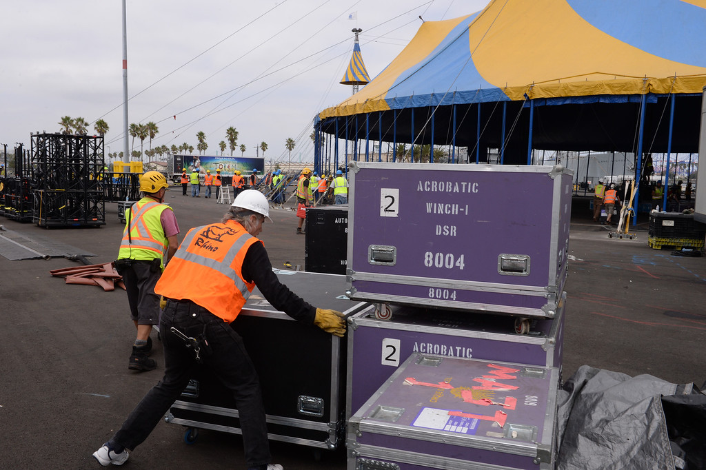 """. Workers around the Cirque du Soleil bigtop tent where the circus is setting up for its performance of \""""Totem\"""" starting Oct. 11. Set up is near the Lane Victory at berth 45. (Oct 2, 2013. Photo by Brad Graverson/The Daily Breeze)"""