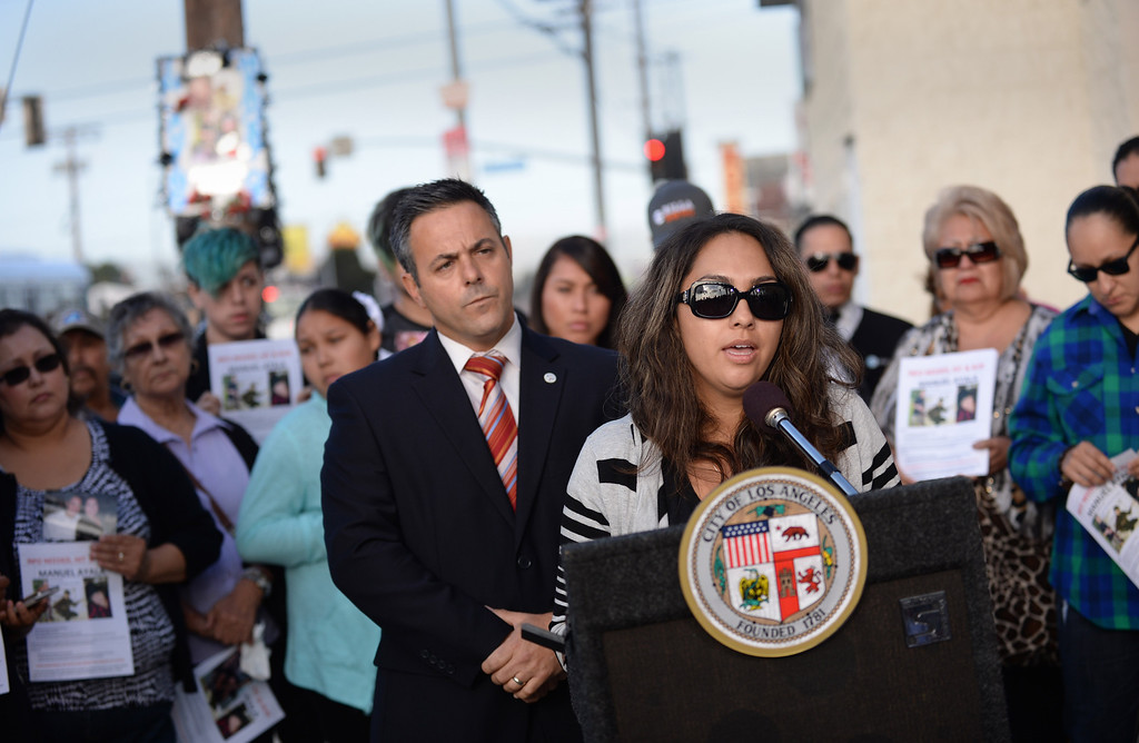 . Brenda Viveros speaks about Manuel Ayala, fatal victim in Wilmington hit-and-run traffic accident 9-16-13. Friends and family gathered Thursday as LA Councilman Joe Buscaino held a press conference to announce reward and legislation to fight hit-and-run drivers. Photo by Brad Graverson 9-26-13/The Daily Breeze.