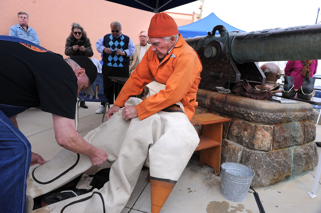 . Torrance R. Parker, an 85 year-old diver, suits up in his vintage diving gear. He has written a second book, - 20,000 Divers Under the Sea. Event hosted at the Martime Museum in San Pedro where his new book is sold. (Wed., 10/23/13 Photo by Brad Graverson/The Daily Breeze)
