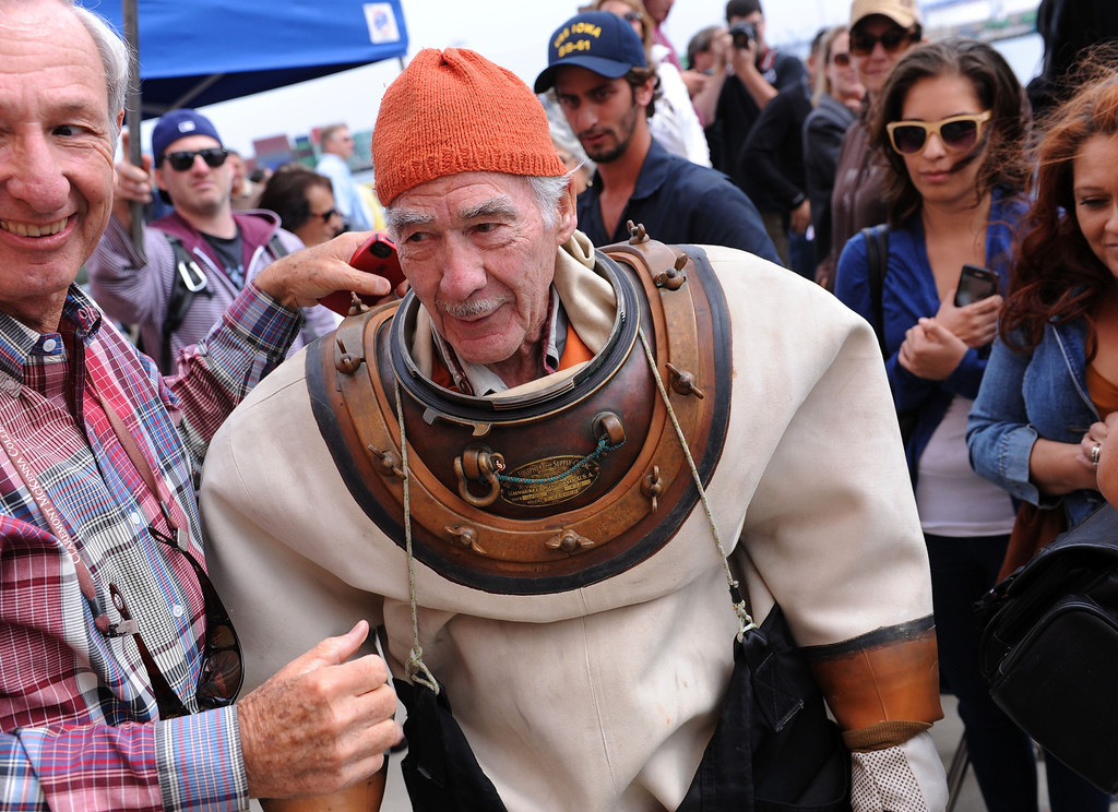 . Torrance R. Parker, an 85 year-old diver, is greeted by well-wishers before his dive in San Pedro. He has written a second book, - 20,000 Divers Under the Sea. Event hosted at the Martime Museum in San Pedro where his new book is sold. (Wed., 10/23/13 Photo by Brad Graverson/The Daily Breeze)