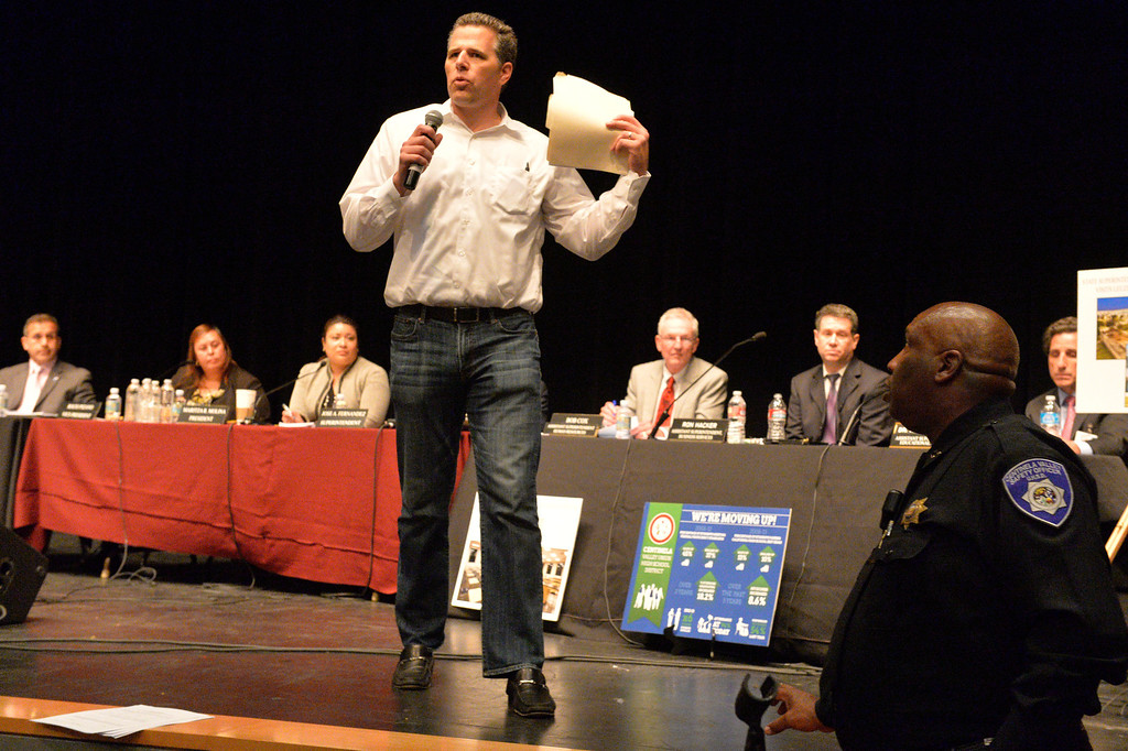 . David Dinnel jumps up on stage to get his message accross as the Centinela Valley school board holds its second school board meeting since the scandal over Superintendent Jose Fernandez\'s employment contract erupted in early February in Lawndale CA. Tuesday March 11, 2014. (Thomas R. Cordova-Daily Breeze/Press-Telegram)