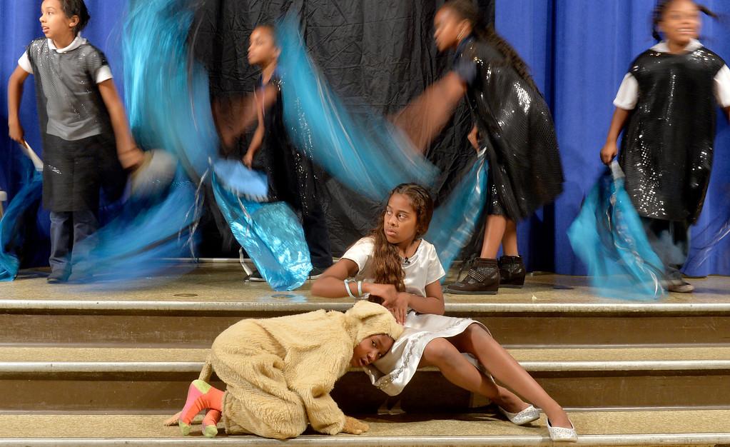 """. Jazlyn Trujillo, 11 Dorothy, Khloe Bayloe, 5 Toto, is surrounded by a \""""storm\"""" as students at Starr King Elementary School rehearse for the musical \""""The Wiz,\""""  which will be the first play at the school in more than a decade in Long Beach, CA. Tuesday June 3, 2014. The play will premiere at the school on Friday. (Thomas R. Cordova-Daily Breeze/Press-Telegram)"""