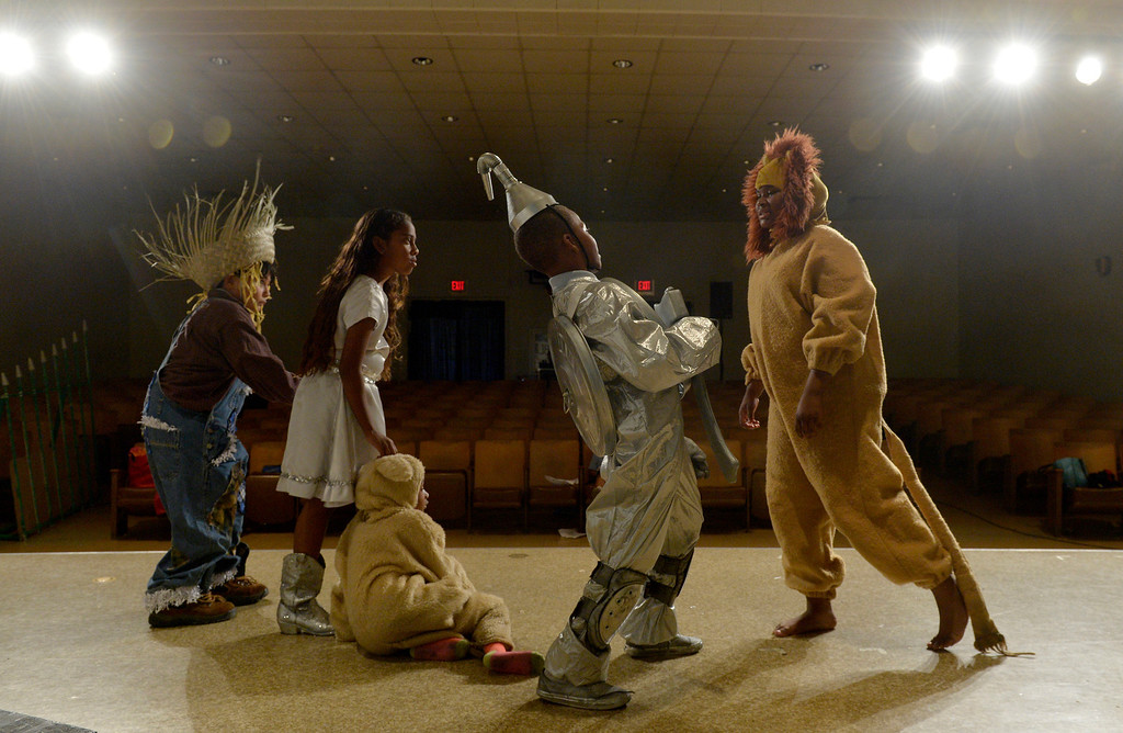 """. Jonay Armstrong, 10 The Lion, Kyle Baptiste, 10 The Tinman, Khloe Bayloe, 5 Toto, Jazlyn Trujillo, 11 Dorothy and David Lozano, 8 The Scarecrow, as students at Starr King Elementary School rehearse for the musical \""""The Wiz,\""""  which will be the first play at the school in more than a decade in Long Beach, CA. Tuesday June 3, 2014. The play will premiere at the school on Friday. (Thomas R. Cordova-Daily Breeze/Press-Telegram)"""
