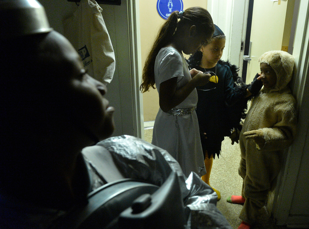 """. Kyle Baptiste, 10 The Tinman left, waits backstage with Khloe Bayloe, 5 Toto, Jazlyn Trujillo, 11 Dorothy, and Kaya Faulkner, 7 who plays one of the crows as students at Starr King Elementary School rehearse for the musical \""""The Wiz,\""""  which will be the first play at the school in more than a decade in Long Beach, CA. Tuesday June 3, 2014. The play will premiere at the school on Friday. (Thomas R. Cordova-Daily Breeze/Press-Telegram)"""