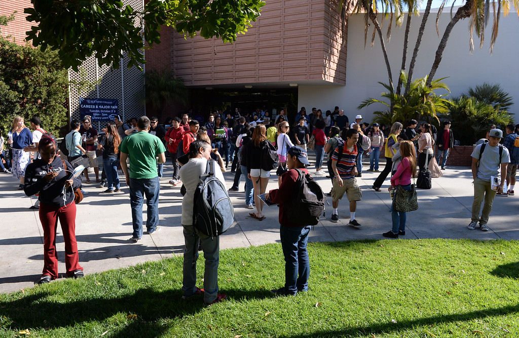 . At El Camino College, students file out of the library during evacuation during the Great California Shake Out, held Thursday morning throughout the state. Photo by Brad Graverson/The Daily Breeze 10/17/13