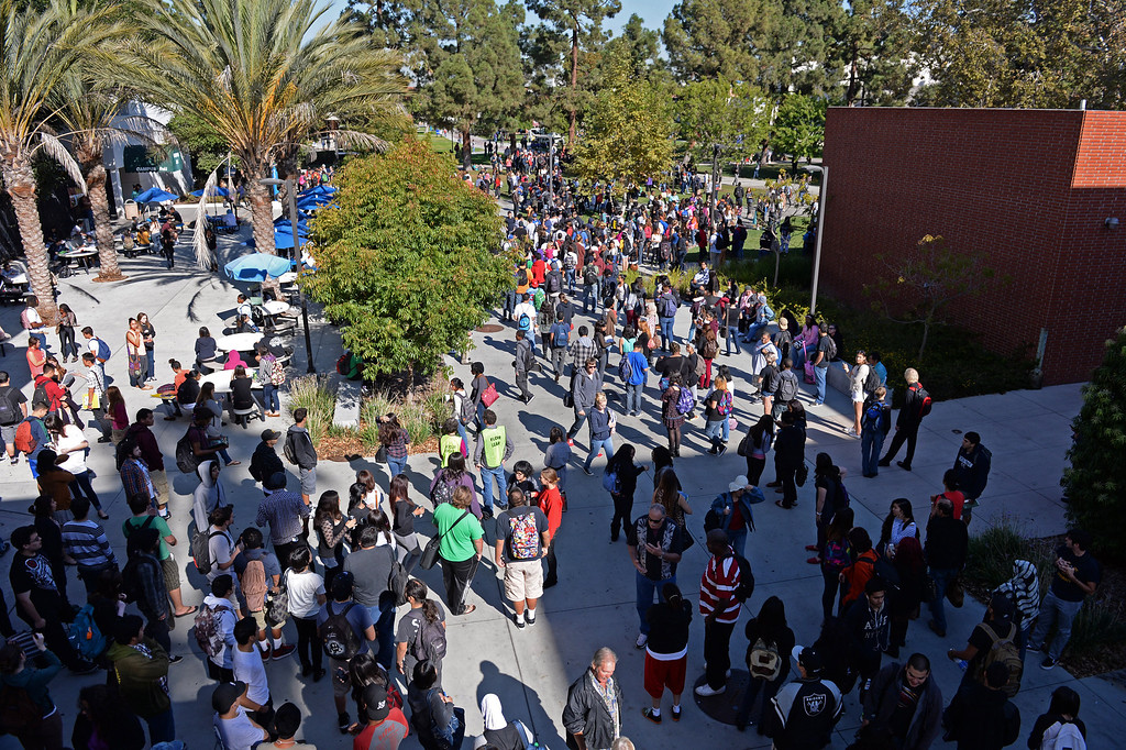. At El Camino College, students wait during the evacuation for the drill called the Great California Shake Out, held Thursday morning throughout the state. Photo by Brad Graverson/The Daily Breeze 10/17/13