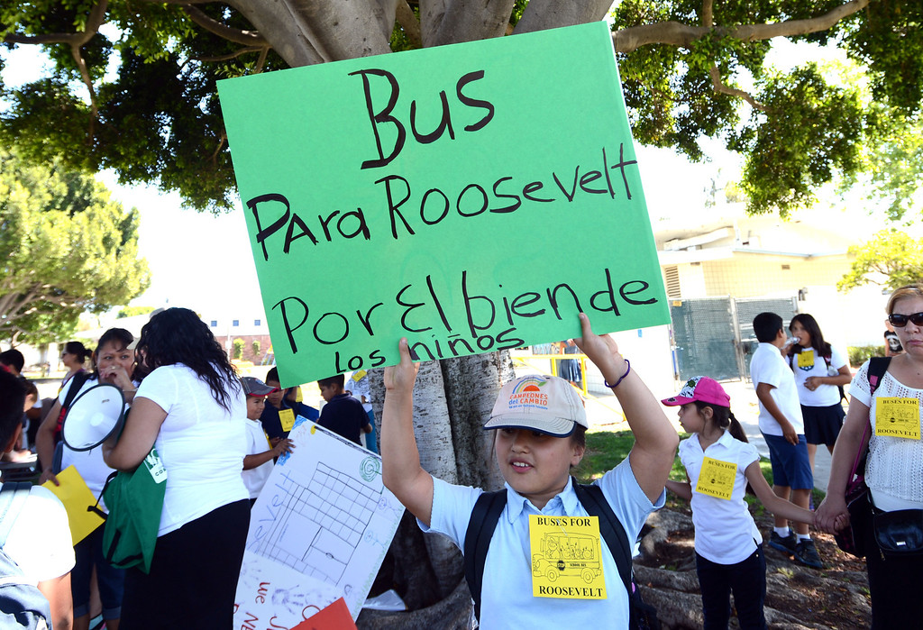 . Roosevelt Elementary School 4th grader Ana Lomenei,9, along with parents  and students from Roosevelt Elementary School, gather at MLK park to voice their concerns about having their children walk four miles roundtrip to and from school now that Roosevelt is under construction. The students have been displaced from their original campus and now have to walk longer than they did to and from school as a result. Students and their families want Long Beach Unified to provide buses for their children, but so far LBUSD hasn\'t complied. Long Beach Calif., Thursday June 5,  2014.     (Photo by Stephen Carr / Daily Breeze)