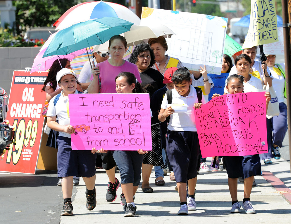 . Parents  and students from Roosevelt Elementary School march along Orange Avenue and Pacific Coast Highway,  to voice their concerns about having their children walk four miles roundtrip to and from school now that Roosevelt is under construction. The students have been displaced from their original campus and now have to walk longer than they did to and from school as a result. Students and their families want Long Beach Unified to provide buses for their children, but so far LBUSD hasn\'t complied. Long Beach Calif., Thursday June 5,  2014.     (Photo by Stephen Carr / Daily Breeze)