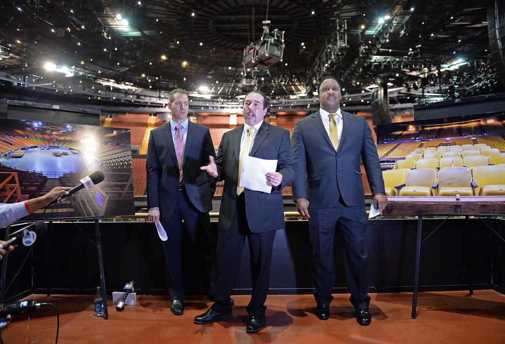 ". The new entertainment venue, the ""Fabulous\"" Forum in Inglewood has undergone a $100 million renovation, and is set to host the Eagles concert series starting Jan 15. Forum GM Nick Spampanato, center, with Sig Greenfig, left, and Mayor James T. Butts, right, tell of all the improvements for the concert goer.    (Jan 14, 2014. Photo by Brad Graverson/The Daily Breeze)"