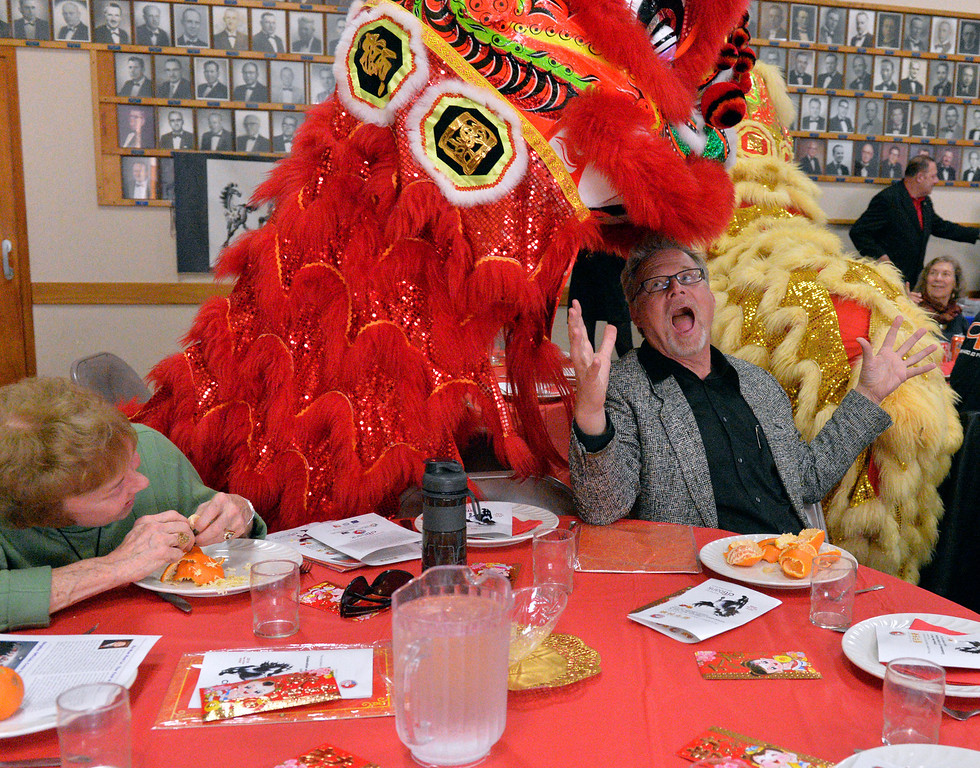 . Gary Mraz plays along during the Awakening Blessing Chinese Lion Dance at the Long Beach - Qingdao Sister City Association\'s 14th Annual Chinese New Year & Celebration of the Spring Festival in Long Beach, CA. Sunday February 9, 2014.  (Thomas R. Cordova/Press-Telegram/Daily Breeze)