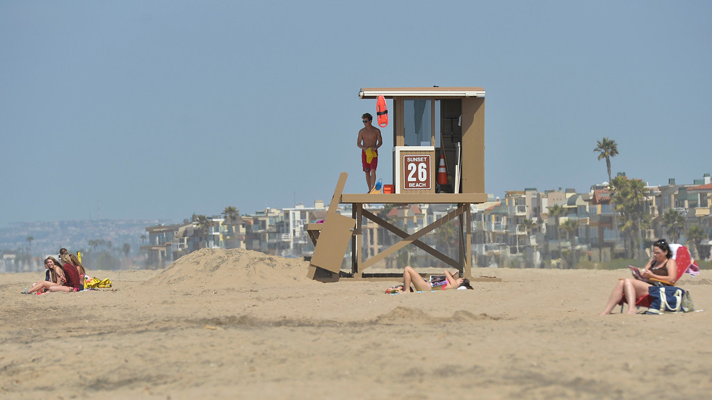 . A life guard on duty at Sunset Beach where a Lakewood man drowned in the ocean after being caught in a powerful rip current the day before in Huntington Beach CA. Wednesday April 16, 2014. (Thomas R. Cordova-Daily Breeze/Press-Telegram)