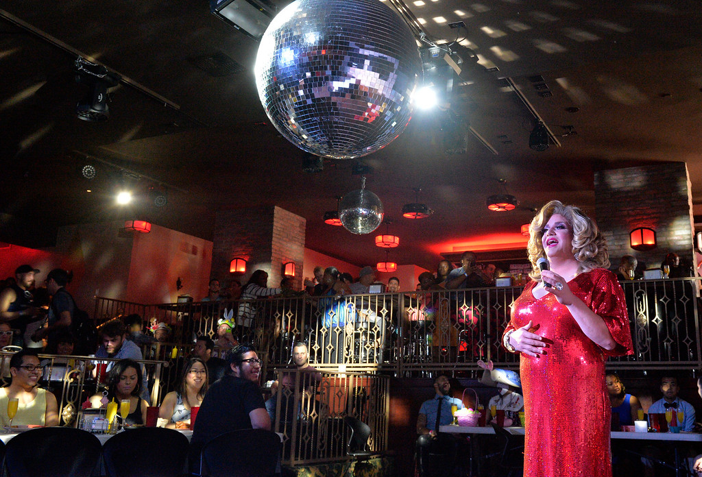 . Under the disco ball Jewels performs at Hamburger Mary\'s at the first stop for the 17th Annual Easter Walk Long Beach as drag queens and members of LGBT community and their straight allies will be stopped in all the gay bars along the corridor doing performances and raising money through raffle prizes and drink specials in Long Beach, CA. Sunday April 20, 2014. All donations and money collected will benefit St. Mary Medical Center�s C.A.R.E Program, the area�s largest comprehensive HIV-AIDS treatment program. (Thomas R. Cordova-Daily Breeze/Press-Telegram)
