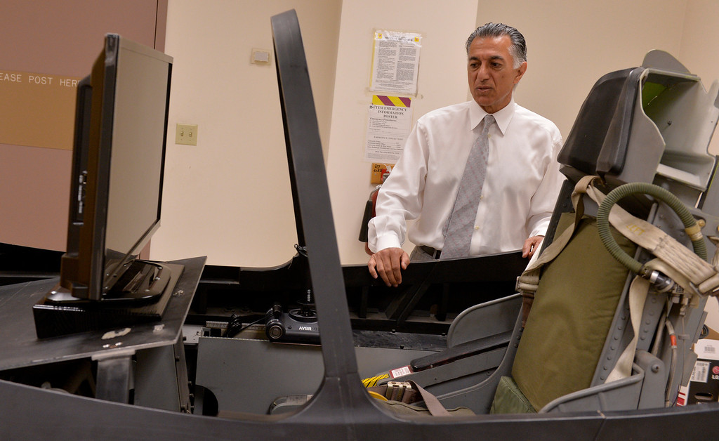 . Dean Forouzan Golshani, of College of Engineering, does a quick walk trough one of the schools labs which contains a F-5 mock cockpit at Cal State University Long Beach in Long Beach, CA. Thursday April 24, 2014. (Thomas R. Cordova-Daily Breeze/Press-Telegram)