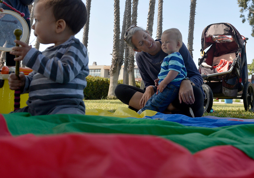 . Stacy Hinkel plays with her son Harrison, 1, along with a group of mothers and their children gather at Marine Stadium in Long Beach, CA. Monday April 21, 2014. The mothers gather every morning at different locations throughout city.  (Thomas R. Cordova-Daily Breeze/Press-Telegram)