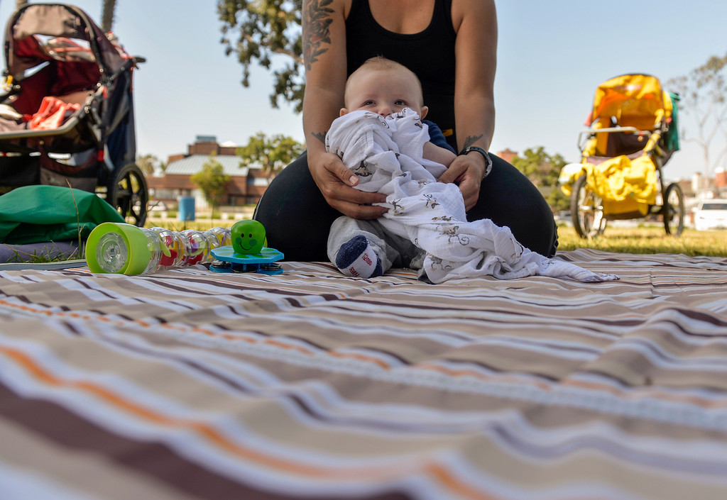 . Riley Dougherty, 4 months, holds his blanket as his mother Liz holds him as a group of mothers and their children gather at Marine Stadium in Long Beach, CA. Monday April 21, 2014. The mothers gather every morning at different locations throughout city.  (Thomas R. Cordova-Daily Breeze/Press-Telegram)