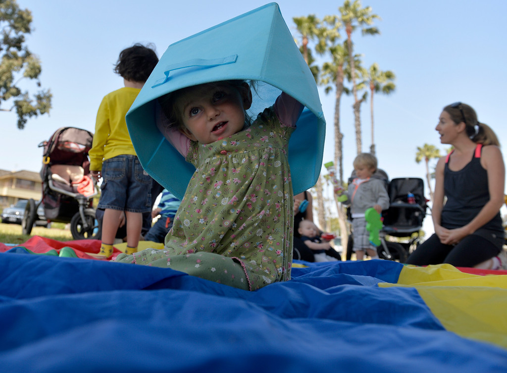 . Ava Grace Murphy, 1, plays with a square carrying bag as a group of mothers and their children gather at Marine Stadium in Long Beach, CA. Monday April 21, 2014. The mothers gather every morning at different locations throughout city.  (Thomas R. Cordova-Daily Breeze/Press-Telegram)