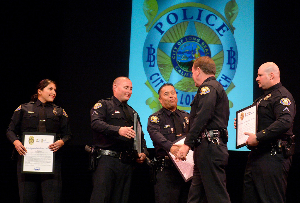 . Long Beach Police Chief Jim McDonnell thanks his officers Left to right: Denise Ruiz, Paul Luyben, Michael Barth and Royce Wexler after they received a award for Meritorious Award for Heroism at the Long Beach Police Department 46th Annual Awards Ceremony in Long Beach, CA. Thursday June 5, 2014. (Thomas R. Cordova-Daily Breeze/Press-Telegram)