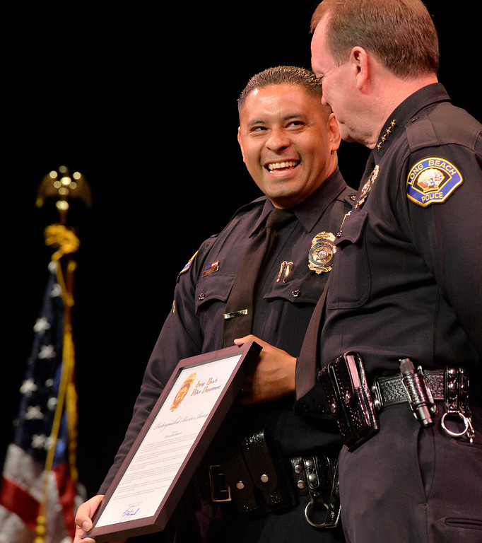 . Police Officer Jode Orantes receives his Distinguished Service Award  as he stands next to Police Chief Jim McDonnell at the Long Beach Police Department 46th Annual Awards Ceremony in Long Beach, CA. Thursday June 5, 2014. (Thomas R. Cordova-Daily Breeze/Press-Telegram)