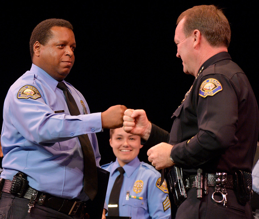 . Volunteer Michael Brown does hand shake with Police Chief Jim McDonnell as Brown receives a award for volunteering more than 500 hours at the Long Beach Police Department 46th Annual Awards Ceremony in Long Beach, CA. Thursday June 5, 2014. (Thomas R. Cordova-Daily Breeze/Press-Telegram)