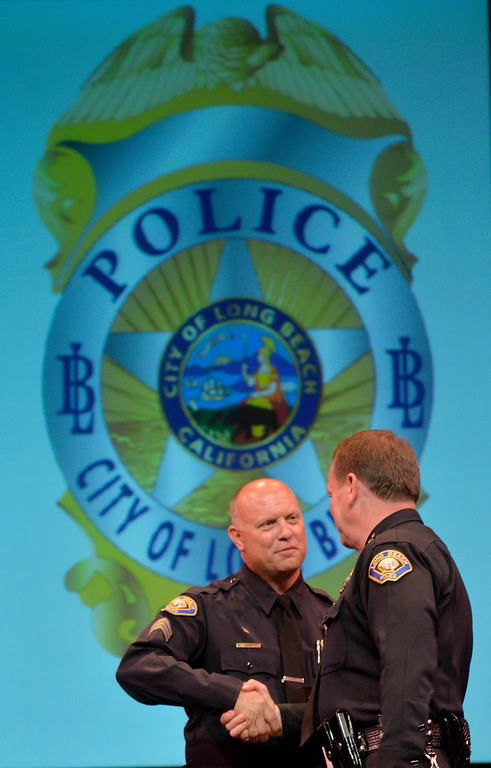 . Police Sergeant Aaron Eaton shakes hands with Police Chief Jim McDonnell after receiving his Distinguished Service Award at the Long Beach Police Department 46th Annual Awards Ceremony in Long Beach, CA. Thursday June 5, 2014. (Thomas R. Cordova-Daily Breeze/Press-Telegram)