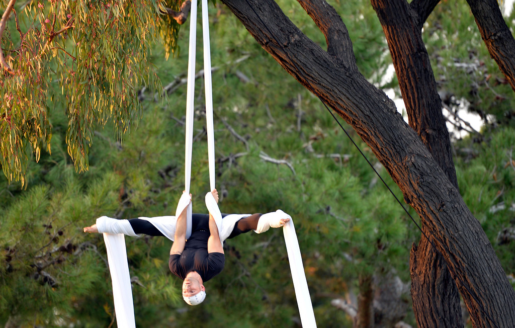 . Lisa La and Vincent Tedino workout on the aerial silks at Mother Beach in Long Beach, CA. December 18, 2013.(Thomas R. Cordova/Press-Telegram/Daily Breeze)