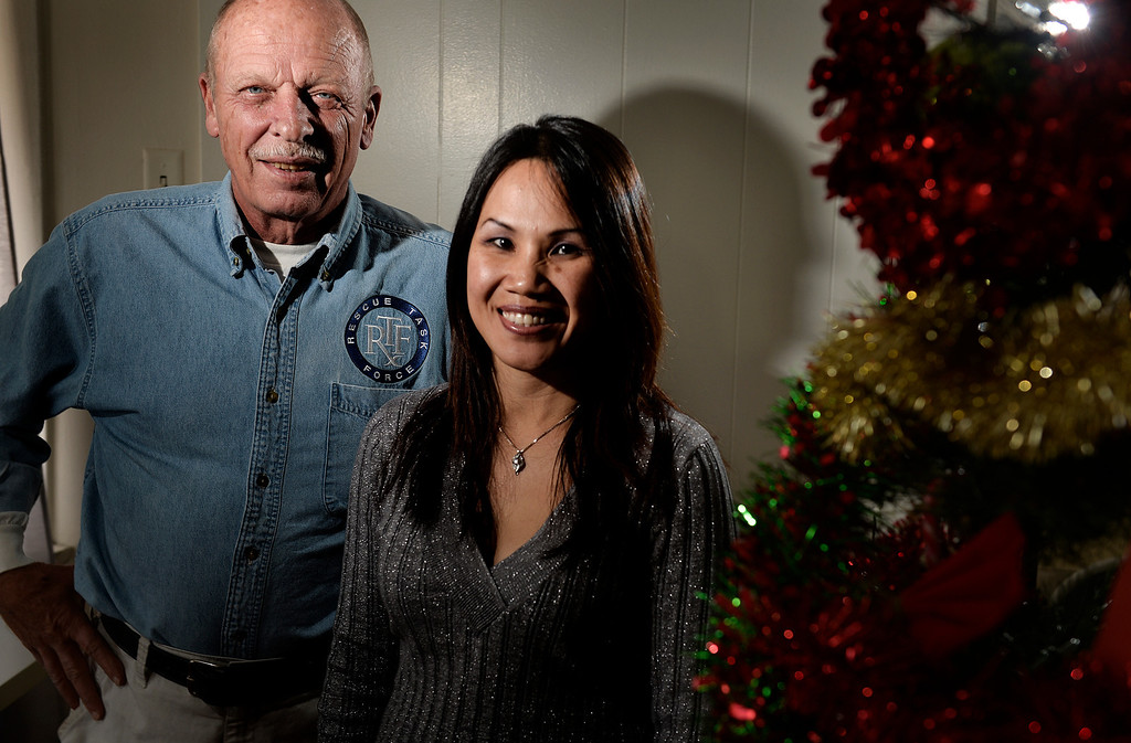". Gary Becks, President and Lakhena ""Lucky\"" Chhuon, Project Coordinator, of Rescue Task Force stands stands next to a Christmas tree at a home in Long Beach, CA. Friday December 20, 2013.  The nonprofit conducts relief efforts around the world, which responds to man-made and natural disasters. (Thomas R. Cordova/Press-Telegram/Daily Breeze)"