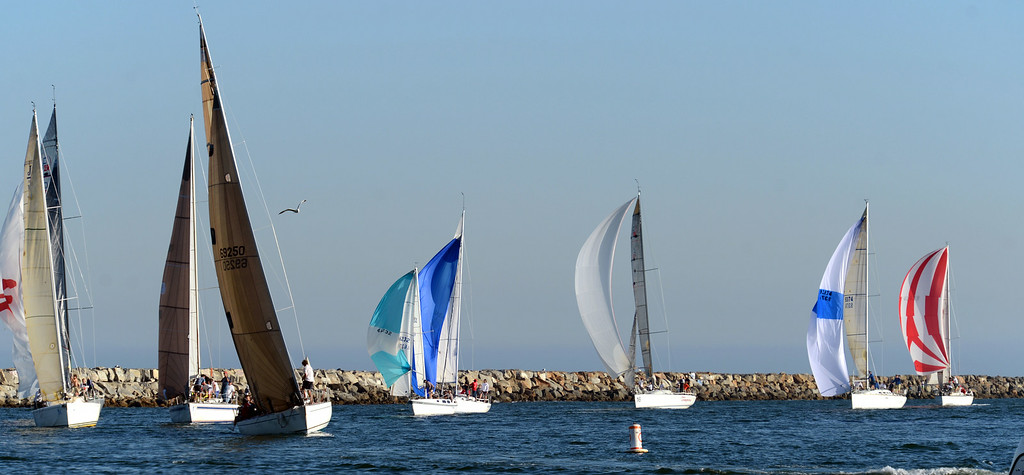 . Sailboats finish a regatta during Big Bang on the Bay,  a community  block party that took place from 5:30 to 9:30 p.m. at The Boathouse on the Bay.  The party featured live music food and flyovers by parachutists and vintage aircraft and topped off by Fireworks over Alamitos Bay. Long Beach Calif.,  Thursday July 3,  2014.    (Photo by Stephen Carr / Daily Breeze)