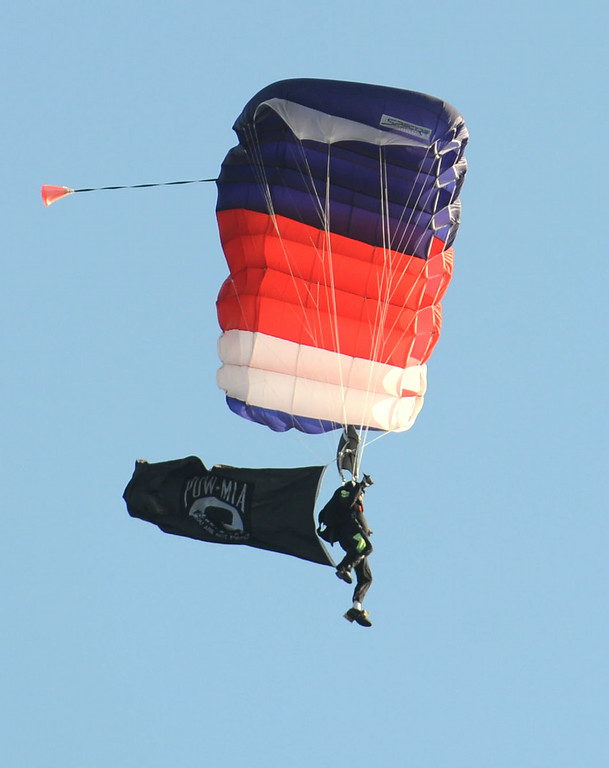 . A parachutist drops from the sky during Big Bang on the Bay,  a community  block party that took place from 5:30 to 9:30 p.m. at The Boathouse on the Bay.  The party featured live music food and flyovers by parachutists, vintage aircraft and topped off by Fireworks over Alamitos Bay. Long Beach Calif.,  Thursday July 3,  2014.    (Photo by Stephen Carr / Daily Breeze)