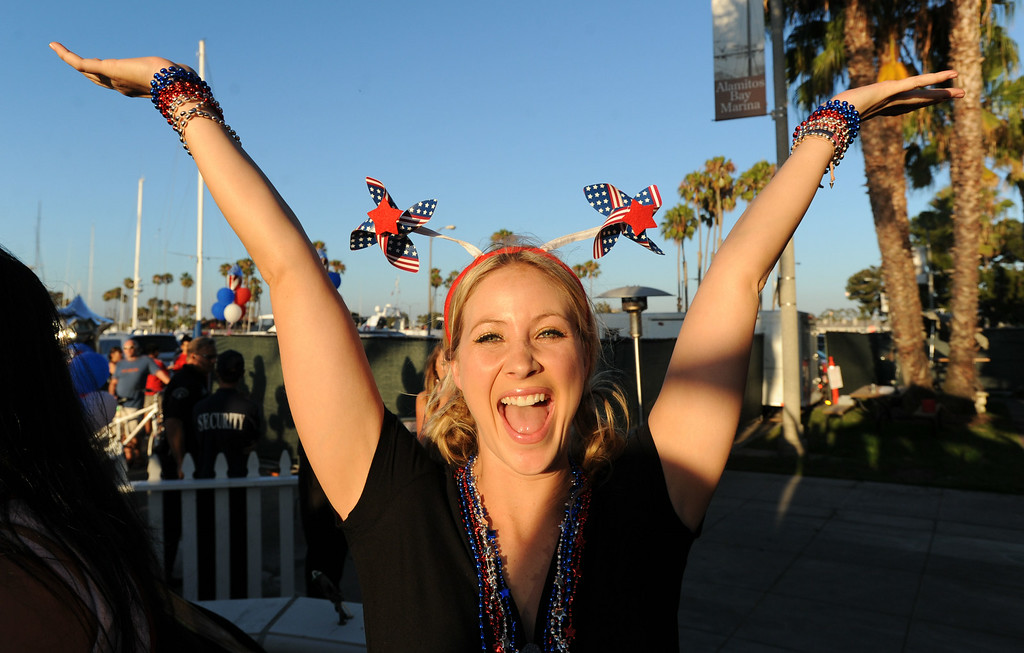 . Boathouse waitress Jordan Wheeler during the Big Bang on the Bay,  a community  block party that took place from 5:30 to 9:30 p.m. at The Boathouse on the Bay.  The party featured live music food,  parachutists, vintage aircraft and topped off by Fireworks over Alamitos Bay. Long Beach Calif.,  Thursday July 3,  2014.    (Photo by Stephen Carr / Daily Breeze)