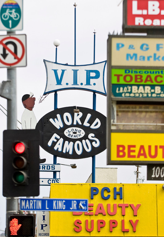 . The VIP Records sign is seen through other street signs on Pacific Coast Highway in Long Beach CA Wednesday October 2, 2013. (Photo by Thomas R. Cordova/ Daily Breeze)